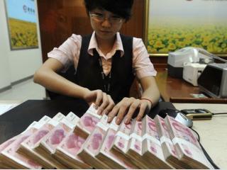 China sta pe un munte de bani - trebuie sa-i puna repede la treaba