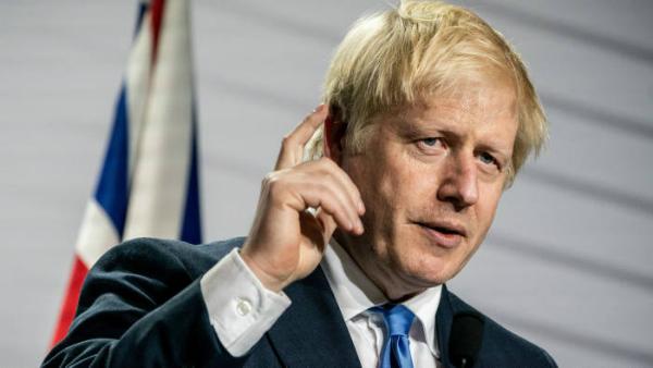 Premierul Marii Britanii, catre Iohannis: Drepturile romanilor din UK vor fi protejate dupa Brexit