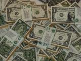 Dolarul este o moneda globala, un simbol al prosperitatii si o proba de foc pentru falsificatori