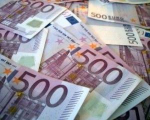 Analisti: Moneda euro va orbita in jurul valorii de 1,24 dolari