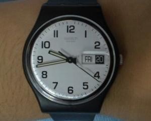 De ce bancherii poarta ceasuri Swatch