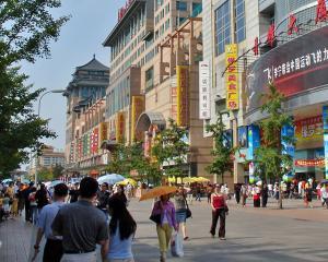 Chinezii, cu mic - cu mare, se muta din sat la oras