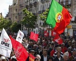 Lovita de criza, Portugalia reduce numarul de zile libere legale