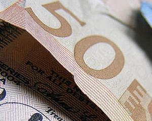 Estimari financiare: Euro ar putea sa scada pana la 1,19 dolari, pe fondul contagiunii grecesti