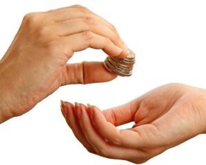ATM-urile din Marea Britanie vor accepta donatii in bani