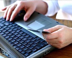 Cei care platesc online facturile Vodafone cu cardul Maestro pot castiga premii