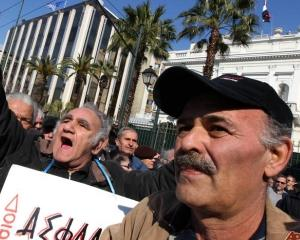 JP Morgan: Retragerea bancilor grecesti din Romania nu ar reprezenta o problema majora pentru sectorul bancar