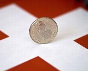 Tandemul aur-franc elvetian atinge noi maxime fata de leu