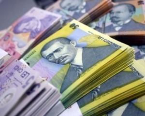 Leul a ajuns la un nou minim fata de euro