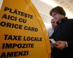 Plata taxelor cu cardul este atractiva pentru romani