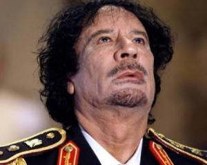 Chirurgul lui Gadhafi vorbeste: Muammar a mancat hamburgeri in timpul operatiei estetice