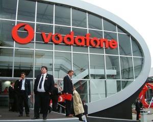 Oficialii Vodafone discuta cu premierul Emil Boc