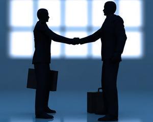Ernst & Young: Piata de fuziuni si achizitii din Romania a scazut in 2010 la 3 miliarde de dolari