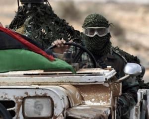 Rebelii libieni pusi pe fuga de Gadhafi