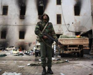 LIBIA: Gadhafi a angajat mercenari din Romania