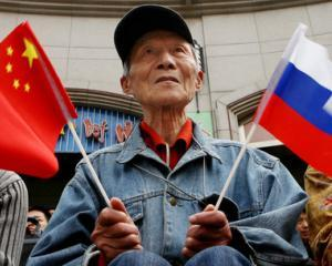 Achizitii ieftine: Rusii si chinezii asalteaza Grecia