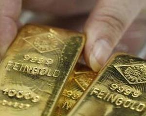 Investitorii se asteapta ca aurul sa scada sub 1.500 de dolari/uncia in primul trimestru din 2012