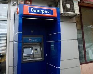 Bancpost reduce dobanda la retragerile de numerar de pe cardurile de credit