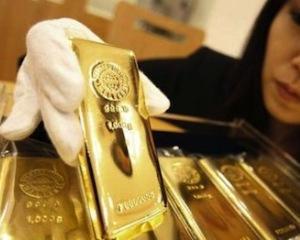 Pretul aurului, in picaj