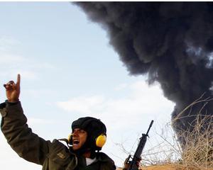 LIBIA: Rebelii lupta cu Gadhafi cu artileria grea, dar si cu diplomatia. Franta recunoaste oficial guvernul insurgentilor