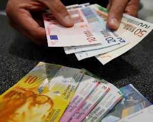 Elvetia cumpara euro pentru a proteja moneda nationala