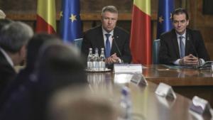 Presedintele si premierul se asaza in jurul mesei, pe tema alegerilor anticipate