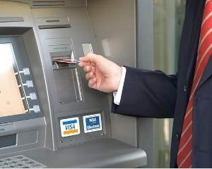 Bancomatul ramane frate cu banii romanilor