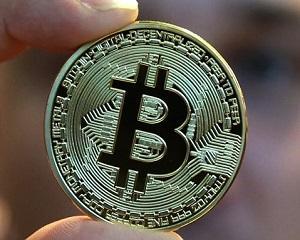 Record pentru Bitcoin: a trecut de 5.000 de dolari. Valoarea ei a depasit de patru ori uncia de aur