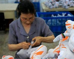 CHINA: Ministrul de finante avertizeaza ca economia ar putea creste cu sub 7%
