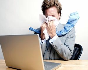 Marea Britanie: Angajatii isi iau tot mai putine zile de concediu medical