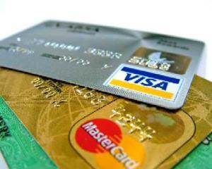 Visa: Tot mai multi romani aleg clic-ul in locul cozii pentru plata taxelor