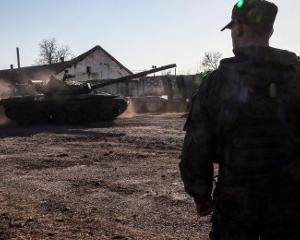Oficial american: Unele companii militare germane i-au instruit pe soldatii rusi detasati in Crimeea