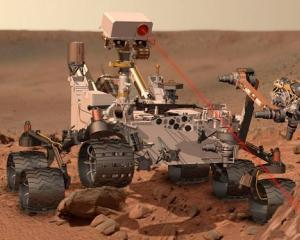 Curiosity a implinit un an de cand a luat contact cu Marte