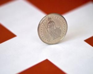 Cursul francului elvetian poate redeveni franc