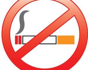 Legea care interzice fumatul in toate spatiile publice inchise a fost adoptata de Camera Deputatilor