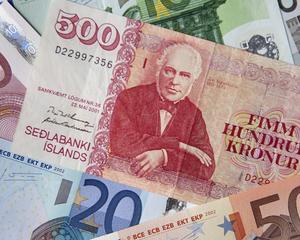 Coroana islandeza si dinarul sarbesc cresc, francul elvetian se depreciaza