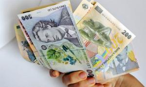 Guvernul Romaniei vrea ca ratele la credite sa scada la jumatate. Expertii: Este imposibil