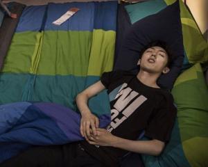 Beijing: Chinezii merg la IKEA ca sa doarma