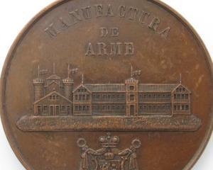 BNR pune in circulatie o moneda de argint dedicata Manufacturii de arme