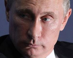 Vladimir Putin risca sa fie tarat prin tribunale de rudele victimelor catastrofei aviatice din Ucraina