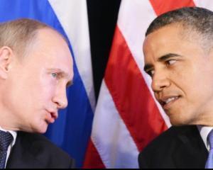 Putin i-a urat lui Obama