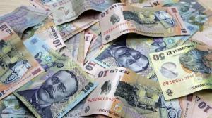 Romanii impart salariul fifty fifty cu statul. Degeaba