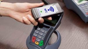 Clientii Raiffeisen Bank pot plati cu telefonul prin RaiPay