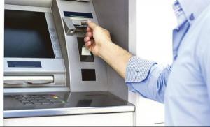 Ati facut tranzactii il ultimele zile la terminalele Raiffeisen cu carduri de la alte banci? Ati platit dublu!