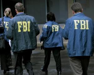 Un fost agent FBI, descoperit vinovat de scurgere de informatii catre AFP