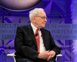 Buffett pariaza pe Hillary