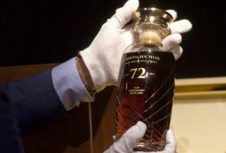 O sticla de Whisky, veche de 72 de ani, vanduta la licitatie la pretul unui apartament